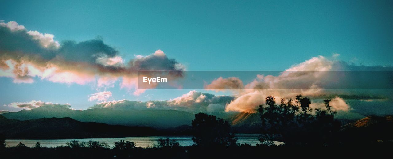 sky, nature, tranquility, scenics, smoke - physical structure, no people, beauty in nature, outdoors, tranquil scene, mountain, silhouette, tree, cloud - sky, landscape, forest fire, day, global warming