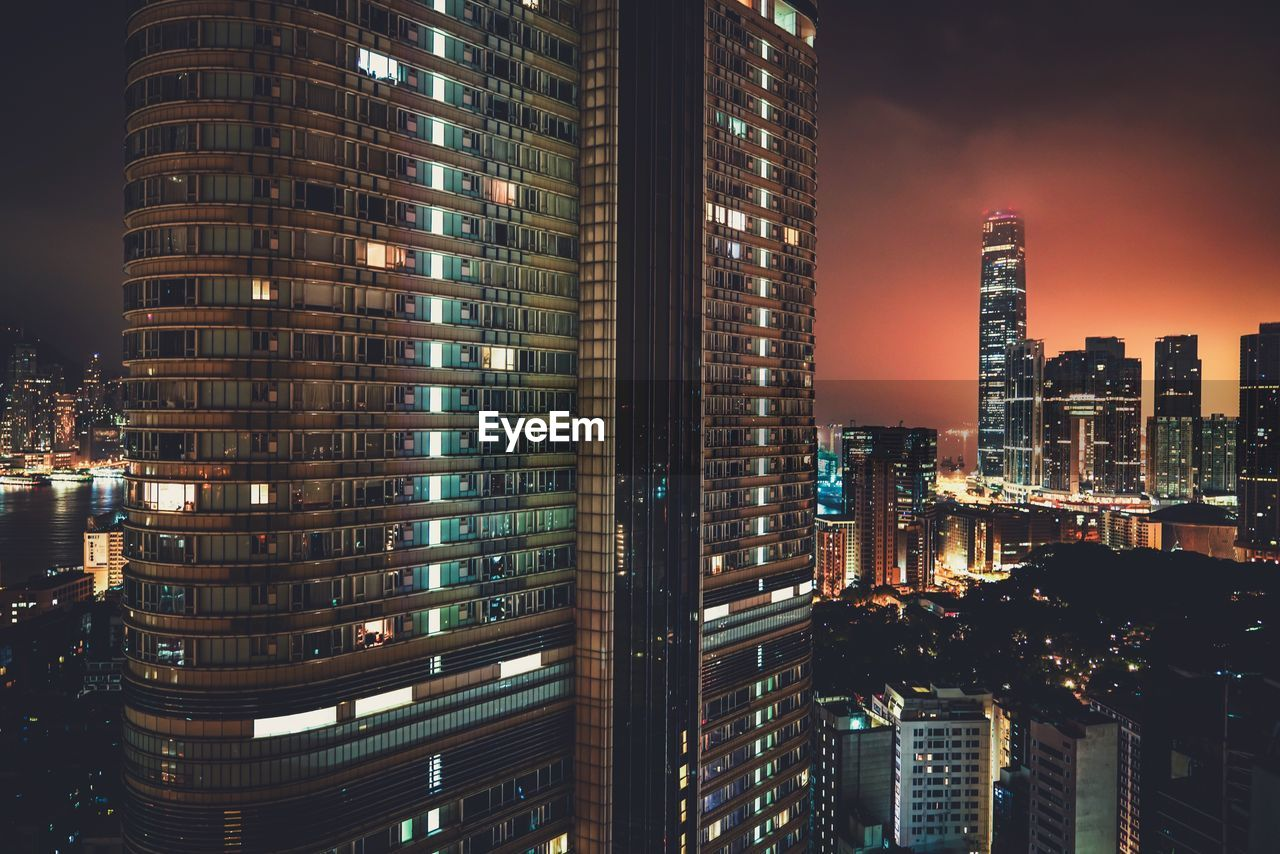 building exterior, architecture, built structure, city, building, illuminated, night, office building exterior, modern, cityscape, skyscraper, tall - high, tower, office, sky, city life, no people, urban skyline, residential district, outdoors, financial district, apartment, nightlife