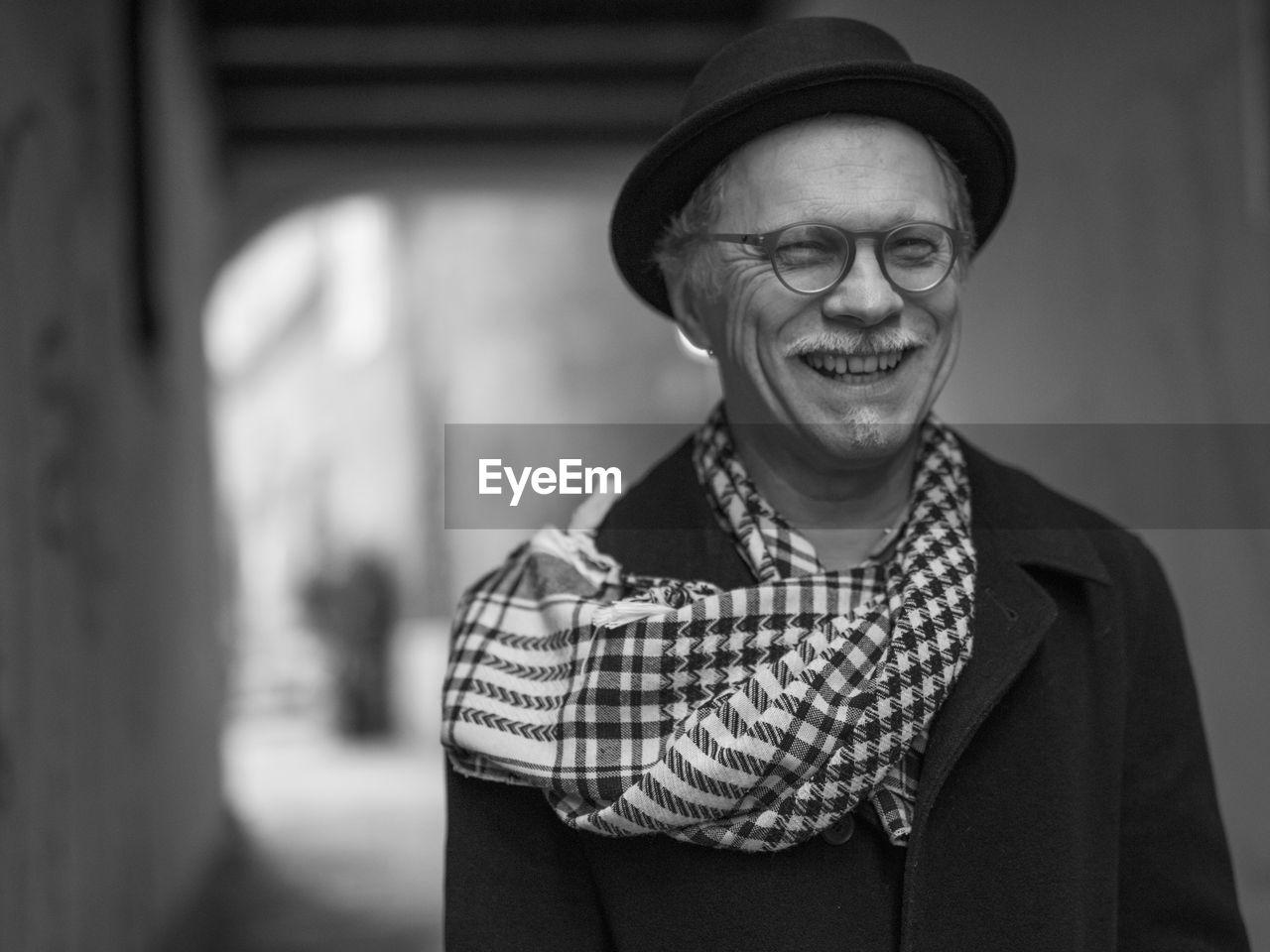 Portrait Of Happy Senior Man Wearing Hat