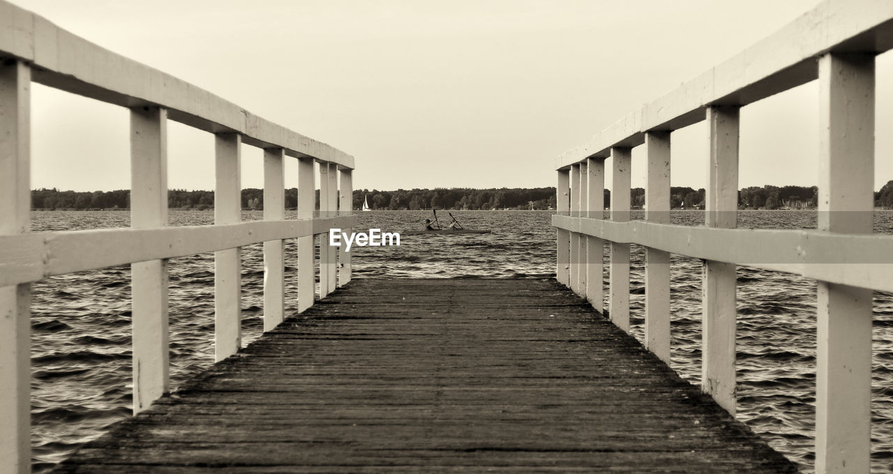 the way forward, wood - material, bridge - man made structure, clear sky, built structure, day, architecture, transportation, outdoors, no people, footbridge, nature, sky, sea, water