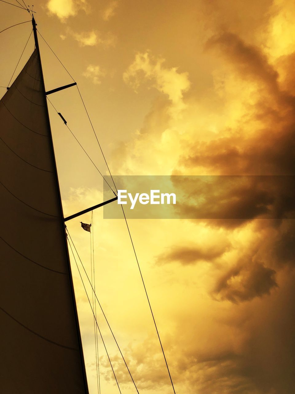 sky, cloud - sky, sunset, low angle view, no people, sailboat, nature, mode of transportation, transportation, mast, pole, nautical vessel, architecture, outdoors, orange color, cable, built structure, beauty in nature, rope, sunlight, power supply