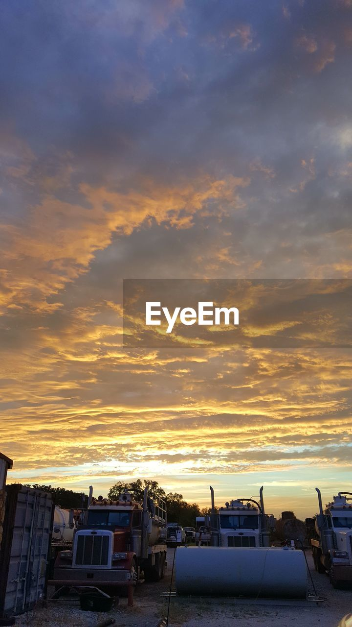 sunset, architecture, building exterior, built structure, sky, orange color, cloud - sky, no people, land vehicle, car, transportation, mode of transport, outdoors, nature, city, beauty in nature, day