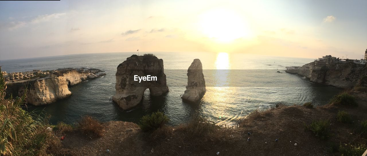 sky, water, sea, horizon, horizon over water, beauty in nature, scenics - nature, tranquil scene, sunset, tranquility, nature, rock, cloud - sky, idyllic, land, rock - object, no people, beach, solid, outdoors, stack rock