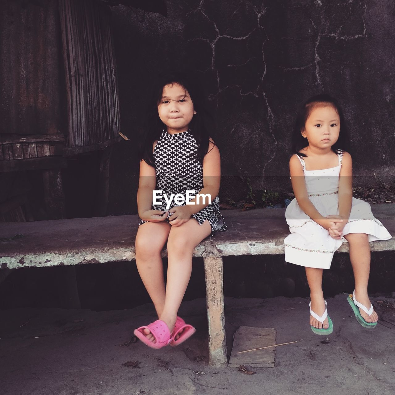 childhood, girls, child, females, full length, women, casual clothing, real people, front view, sister, sibling, looking at camera, portrait, sitting, family, people, two people, togetherness, standing, innocence