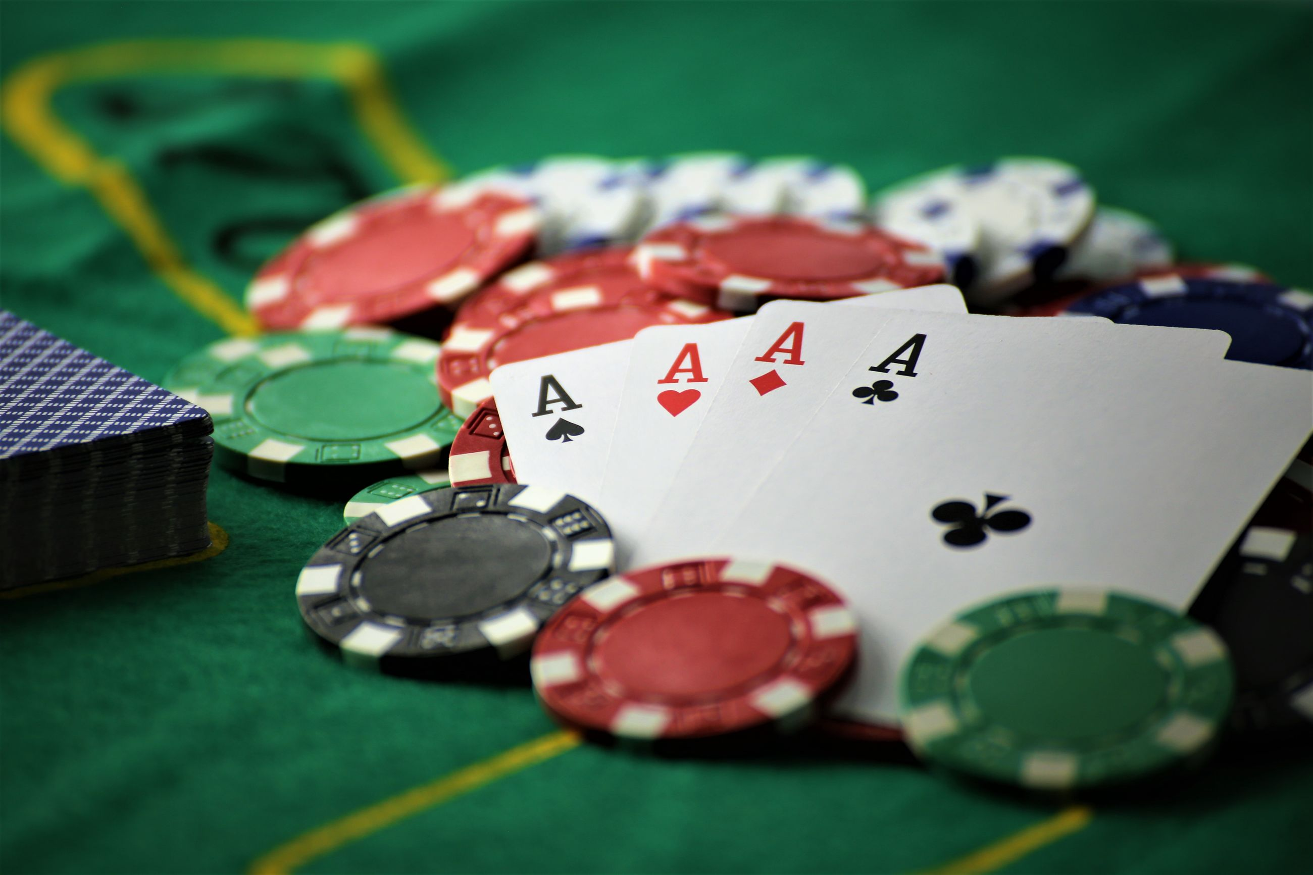 Close-up of playing cards and gambling chips on table