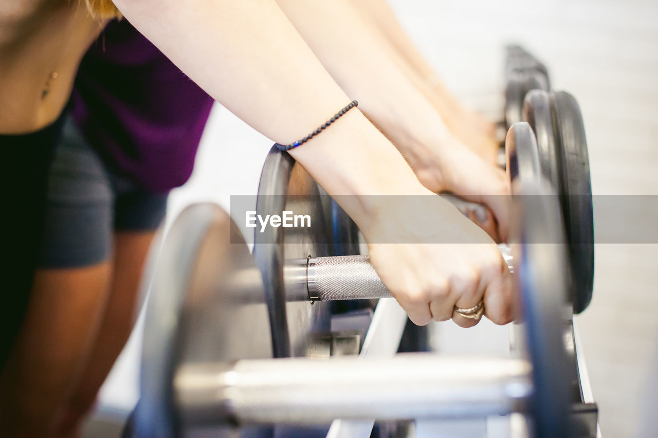 Midsection Of Women Exercising In Gym