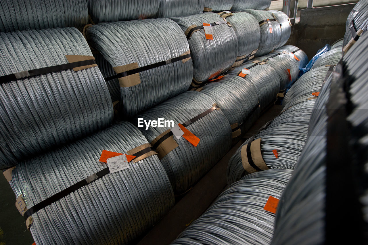 High Angle View Of Metallic Rolled Up Wires At Steel Plant