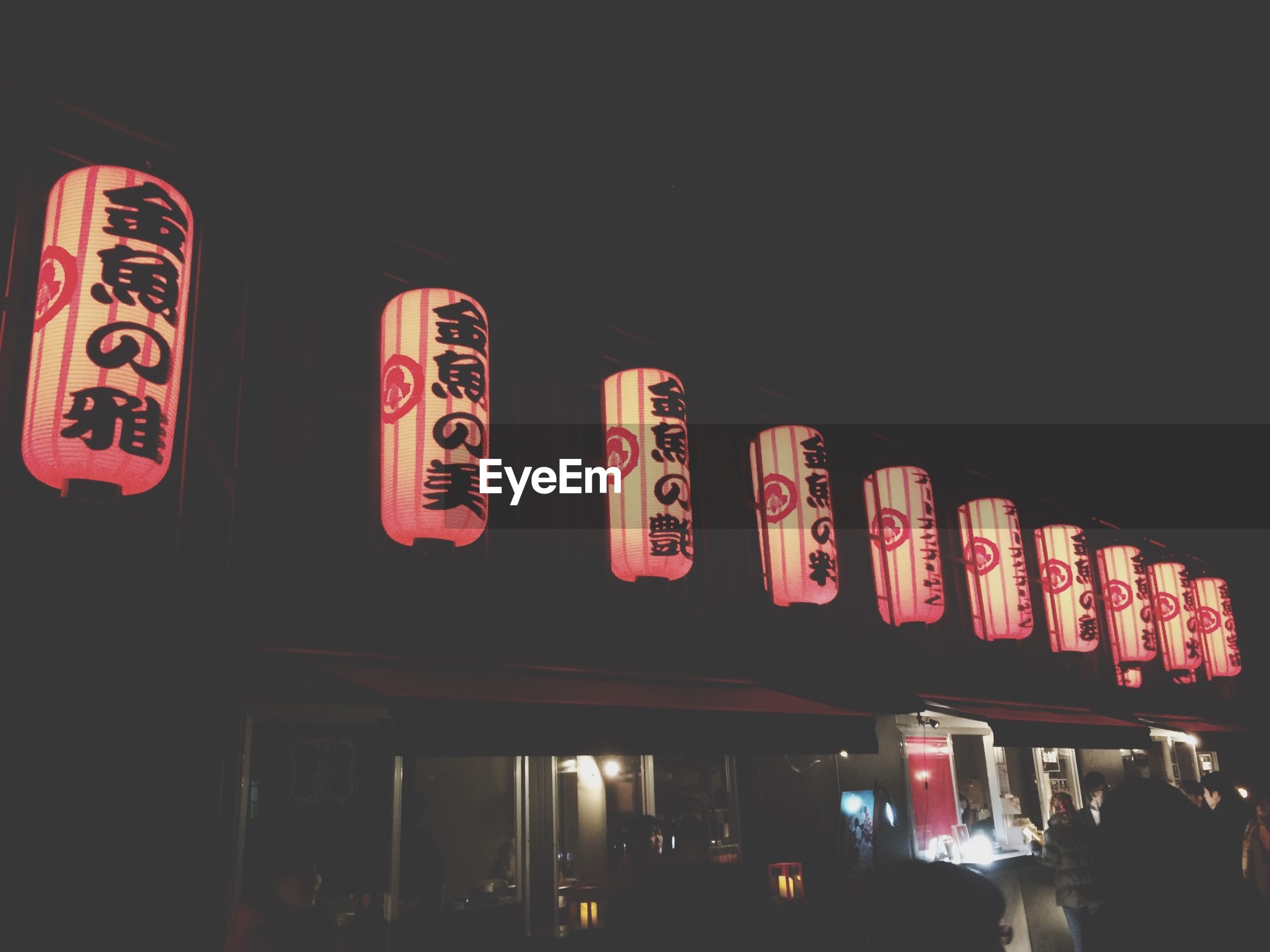 text, western script, illuminated, night, communication, non-western script, built structure, architecture, low angle view, in a row, store, red, indoors, information, building exterior, information sign, advertisement, capital letter, incidental people, sign