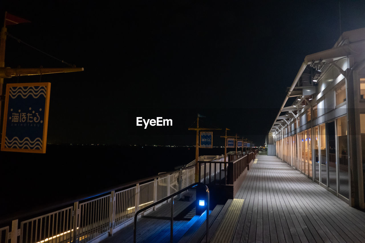 night, illuminated, architecture, built structure, railing, sky, the way forward, direction, building exterior, nature, no people, connection, copy space, lighting equipment, clear sky, footpath, bridge, transportation, street light, bridge - man made structure, outdoors
