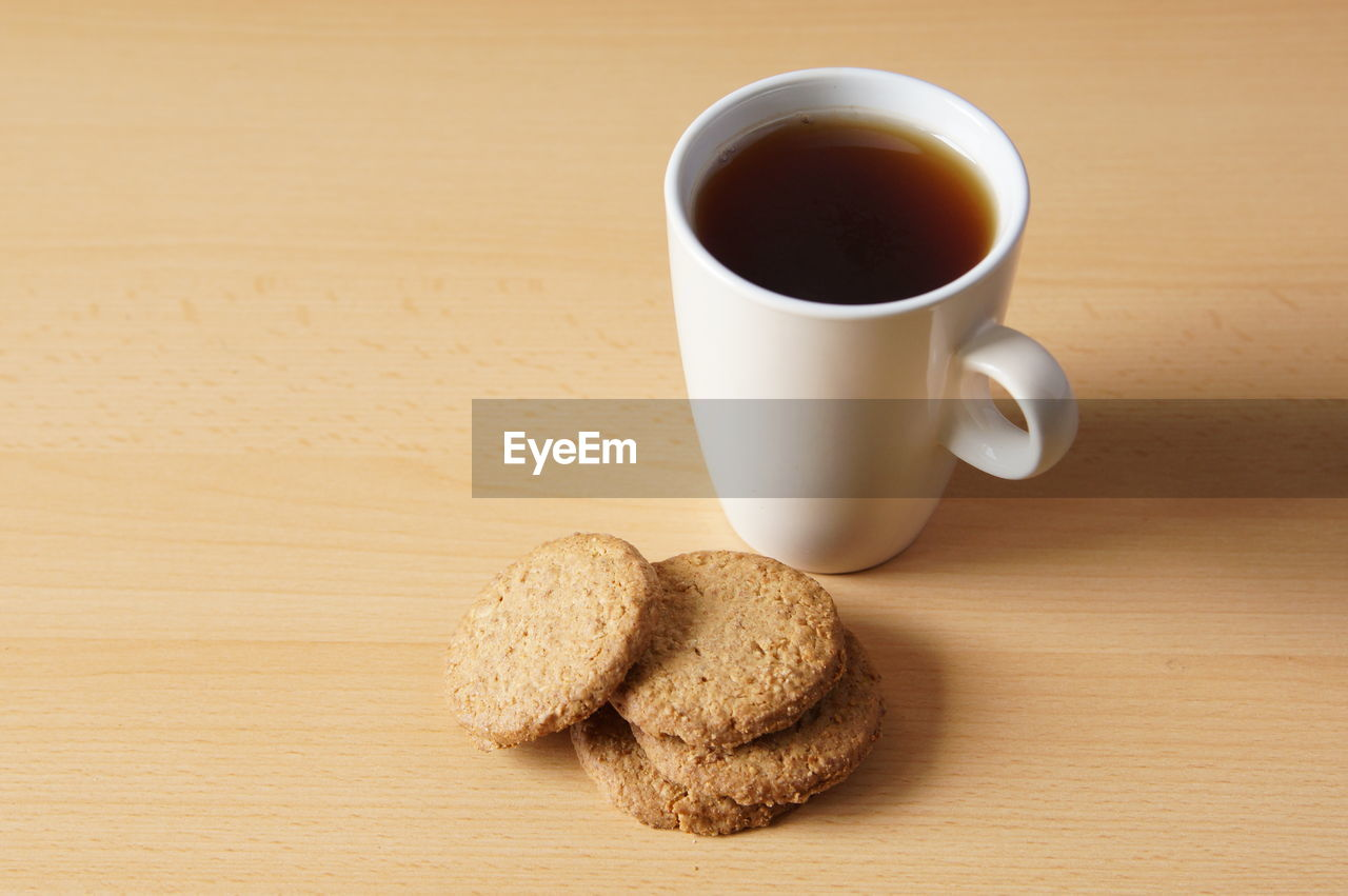 Close-Up Of Cookies And Coffee On Table