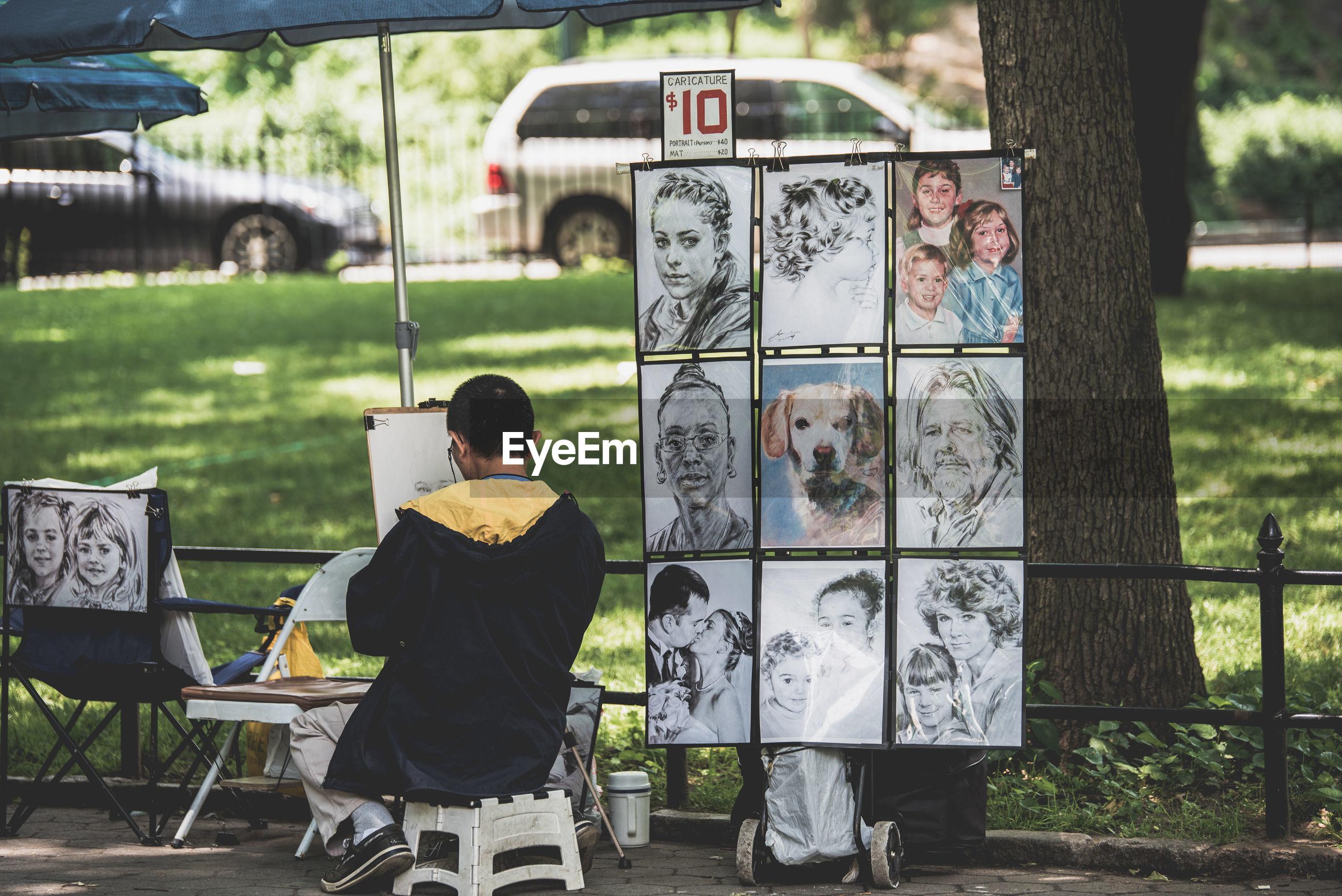 Man making sketch against at park