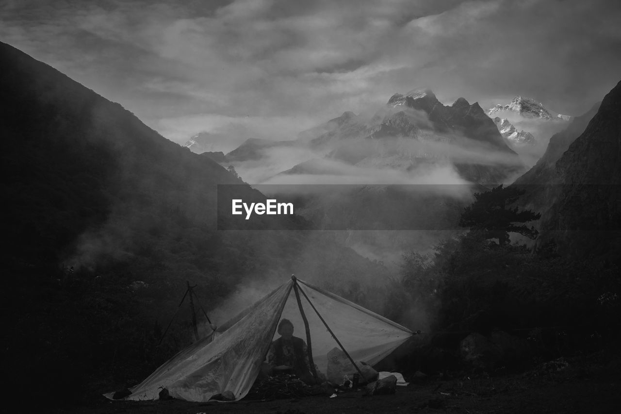 mountain, sky, scenics - nature, beauty in nature, fog, environment, cloud - sky, mountain range, nature, tranquil scene, non-urban scene, landscape, tent, tranquility, day, outdoors, idyllic, no people, camping, mountain peak, snowcapped mountain