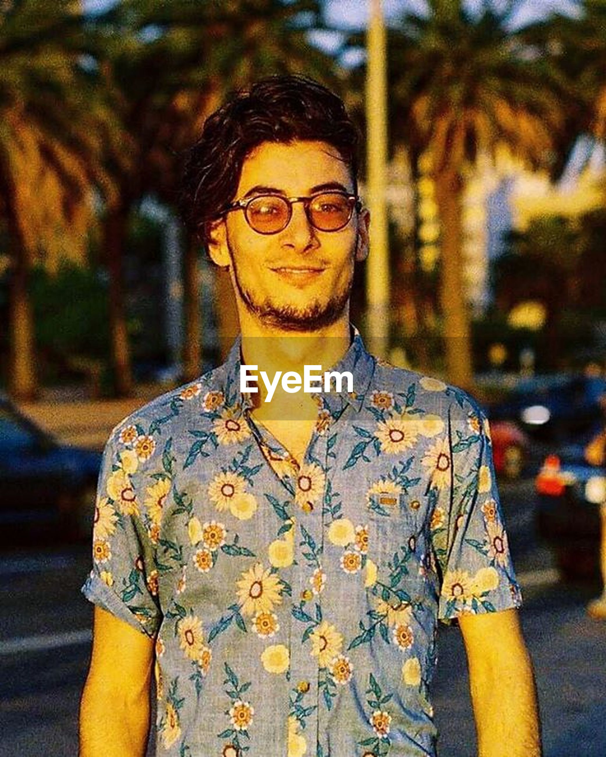 lifestyles, front view, focus on foreground, casual clothing, person, young adult, looking at camera, leisure activity, standing, portrait, young men, sunglasses, waist up, close-up, three quarter length, headshot, handsome, smiling