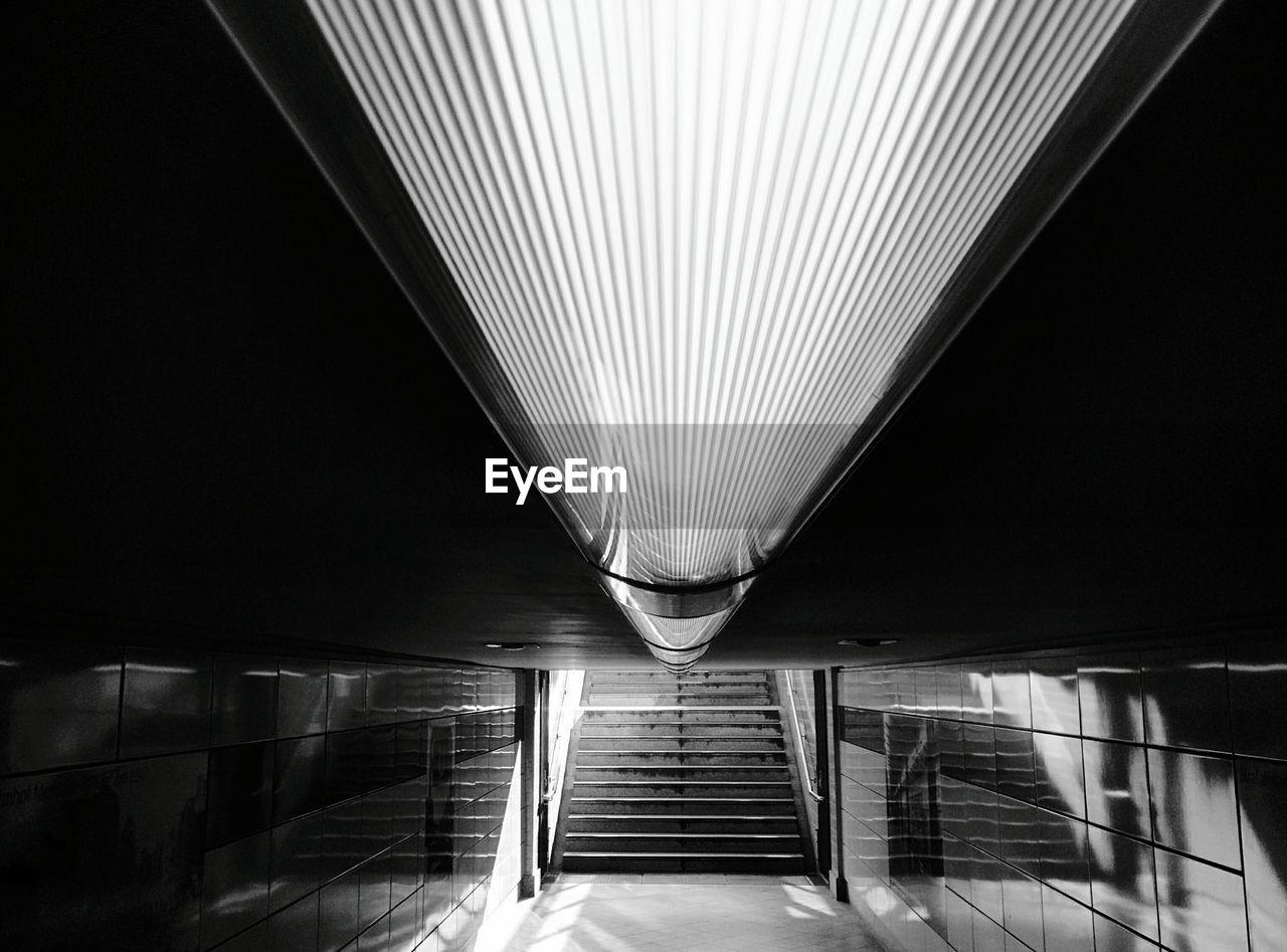Illuminated Light Fixture At Subway Station