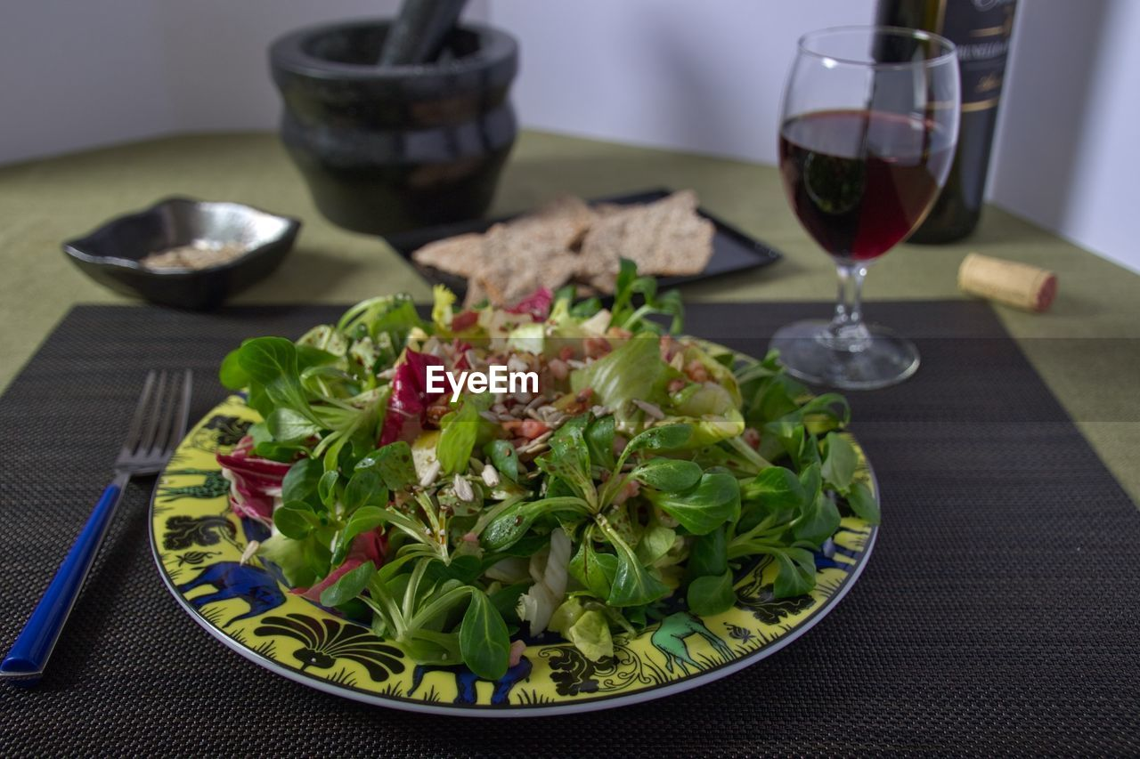 food and drink, salad, healthy eating, freshness, plate, food, table, bowl, indoors, vegetable, ready-to-eat, no people, lettuce, wineglass, close-up, day