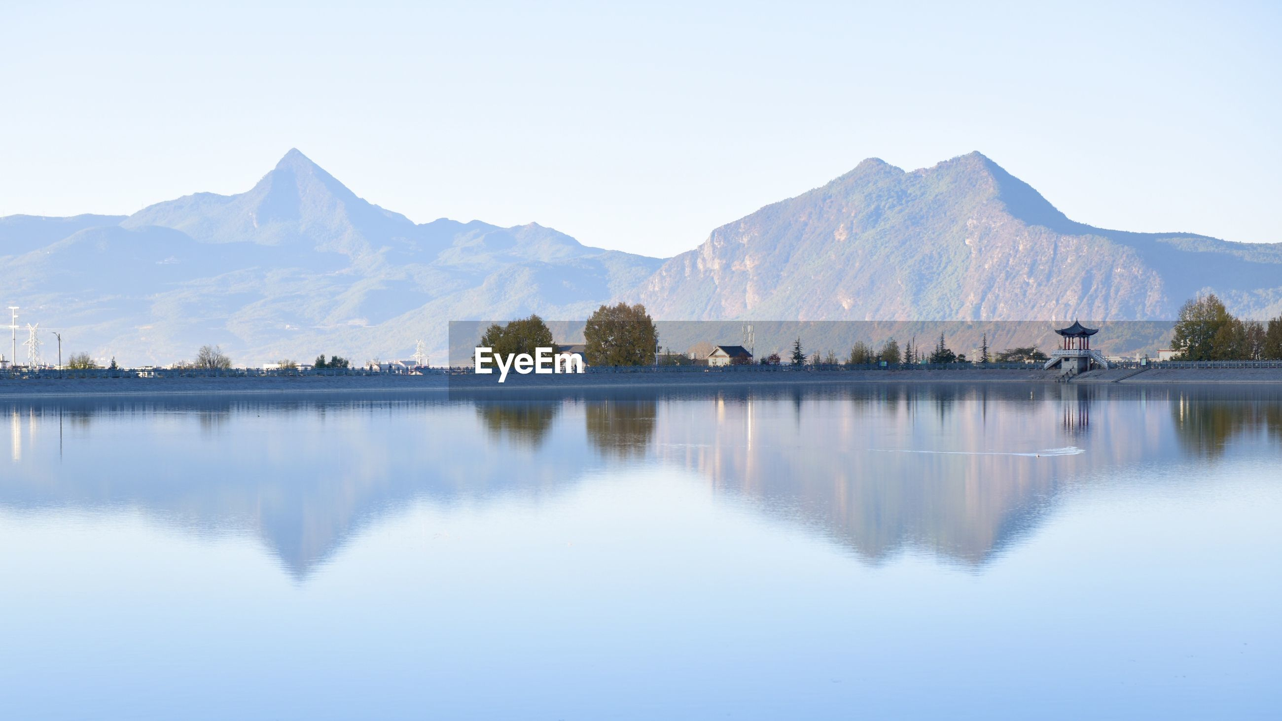 Panoramic view of lake with mountain range in background