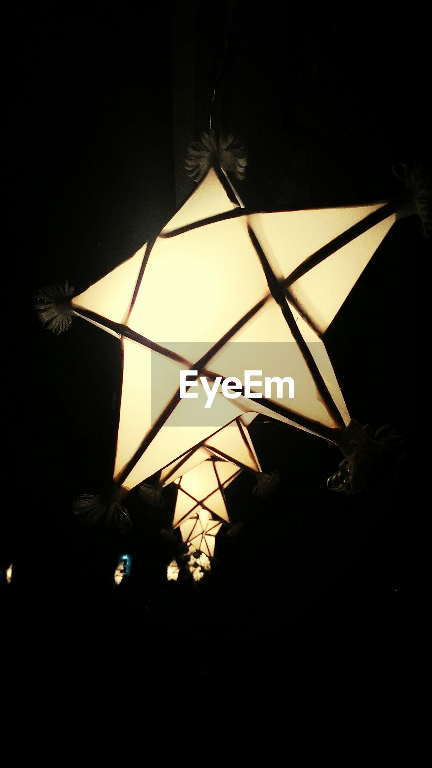 Star shape lanterns on dark background