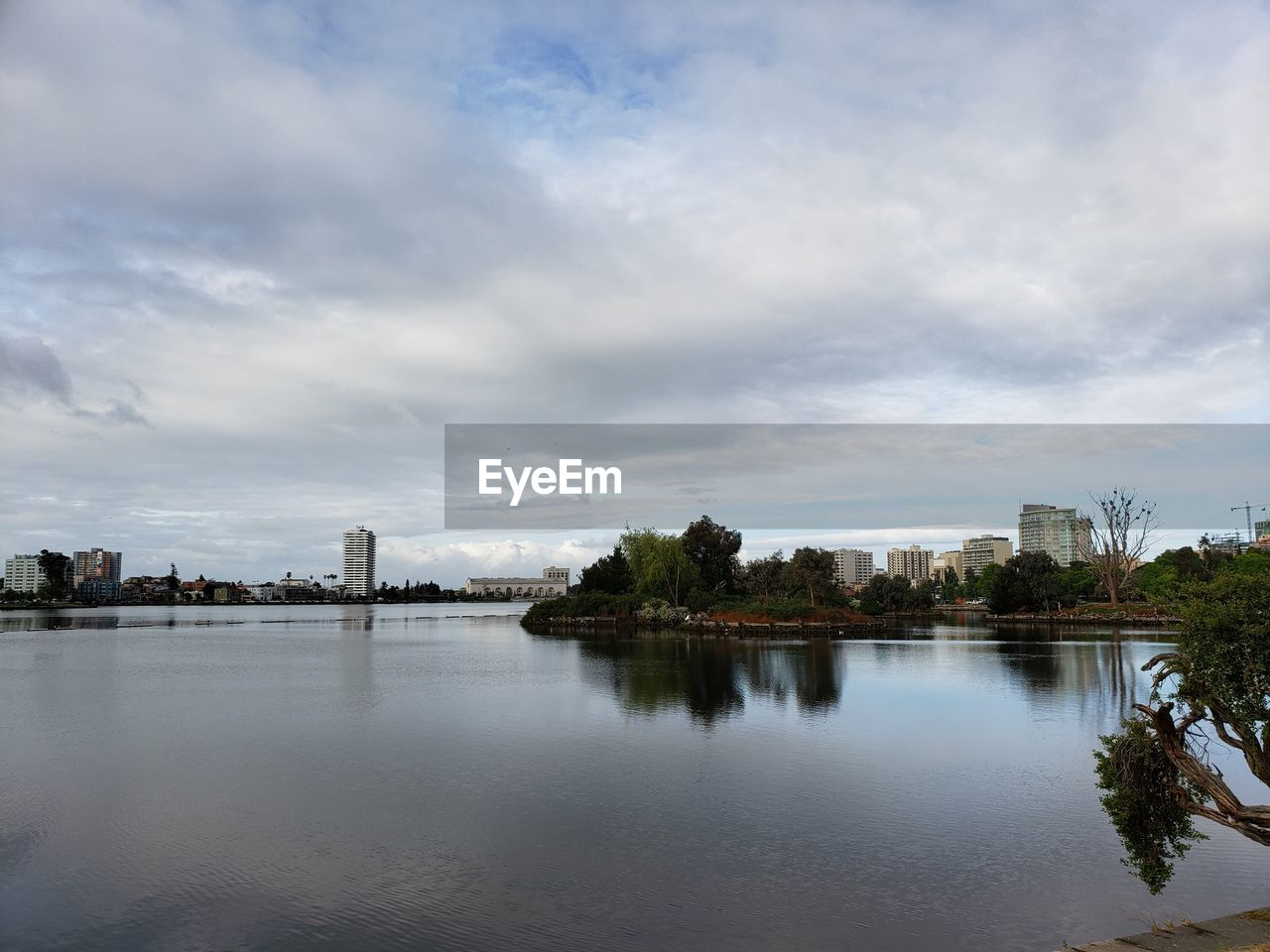 cloud - sky, sky, water, architecture, building exterior, built structure, waterfront, reflection, nature, tree, river, plant, no people, city, outdoors, travel destinations, building, day
