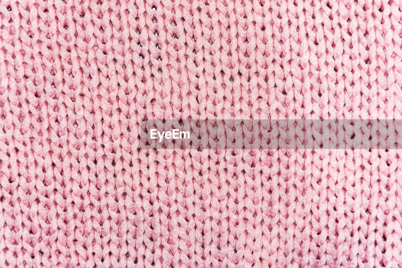 Full Frame Shot Of Pink Knitted Fabric