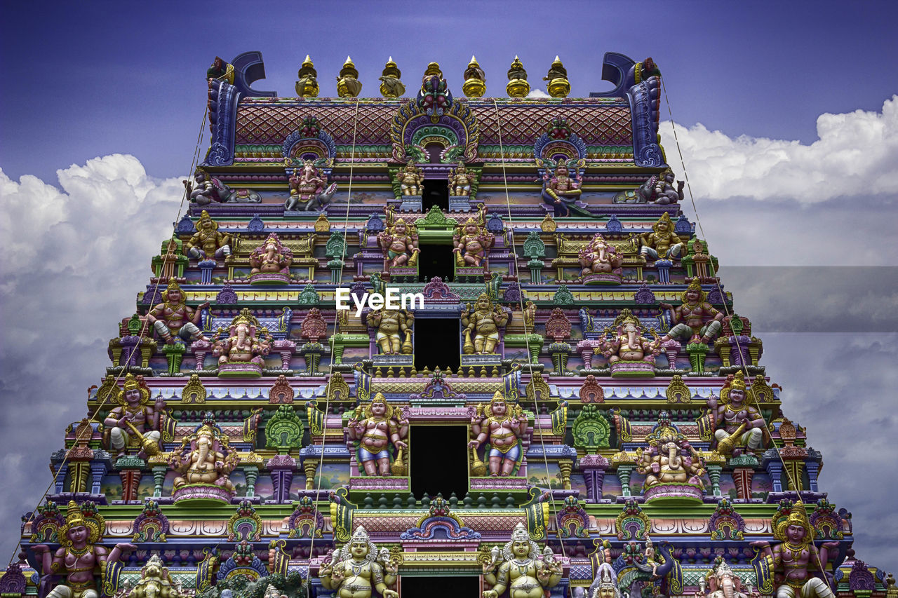 Low Angle View Of Historic Colorful Temple Against Cloudy Sky