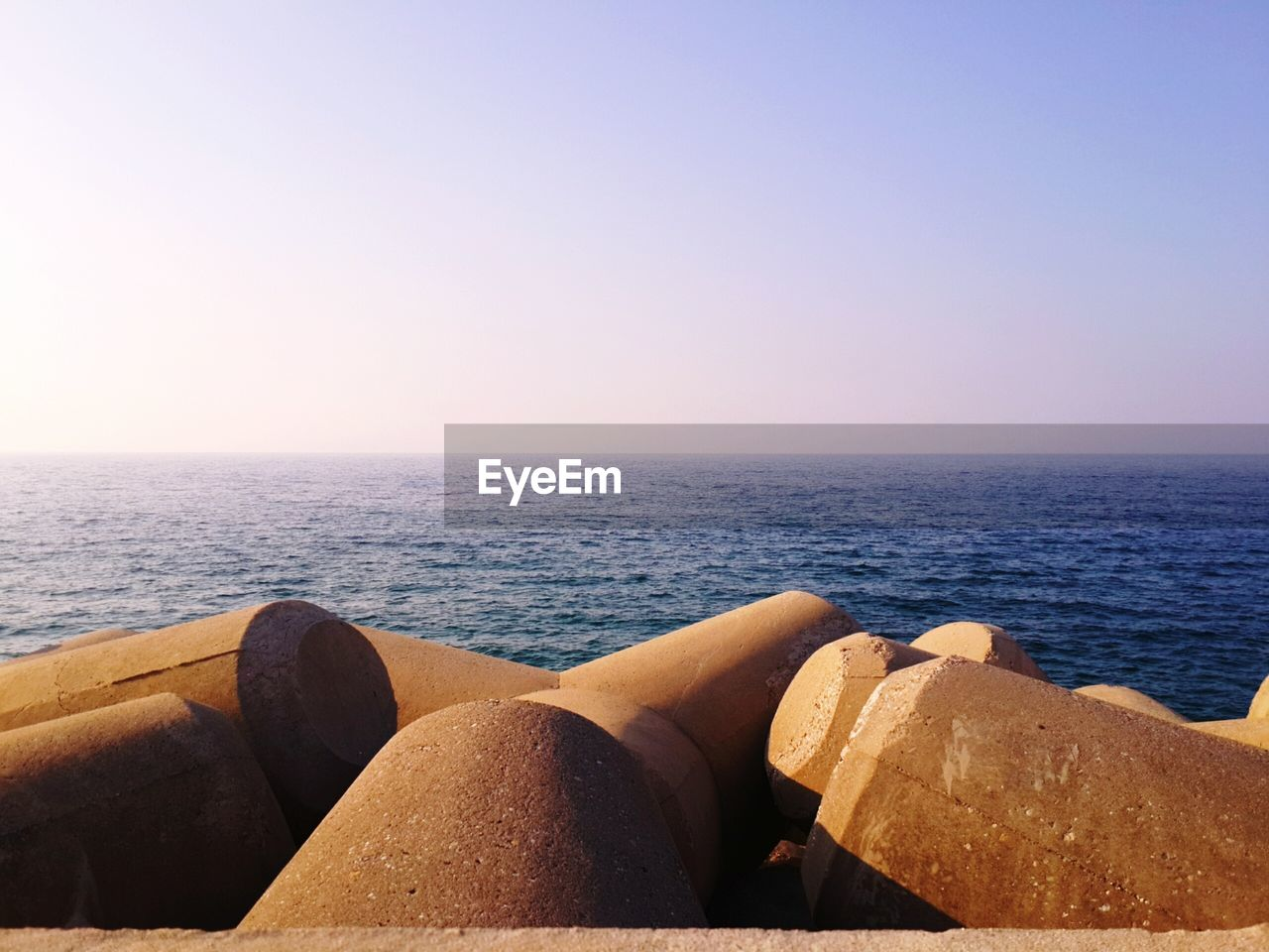 sea, horizon over water, water, nature, scenics, tranquility, tranquil scene, outdoors, beauty in nature, clear sky, day, beach, no people, sky, close-up, pebble beach