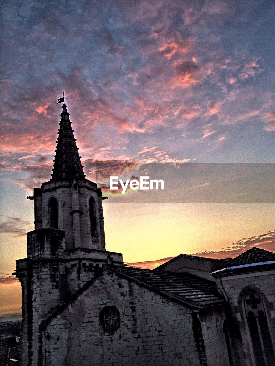 religion, spirituality, architecture, sunset, place of worship, building exterior, built structure, sky, no people, history, low angle view, outdoors, cloud - sky, travel destinations, bell tower, nature, day