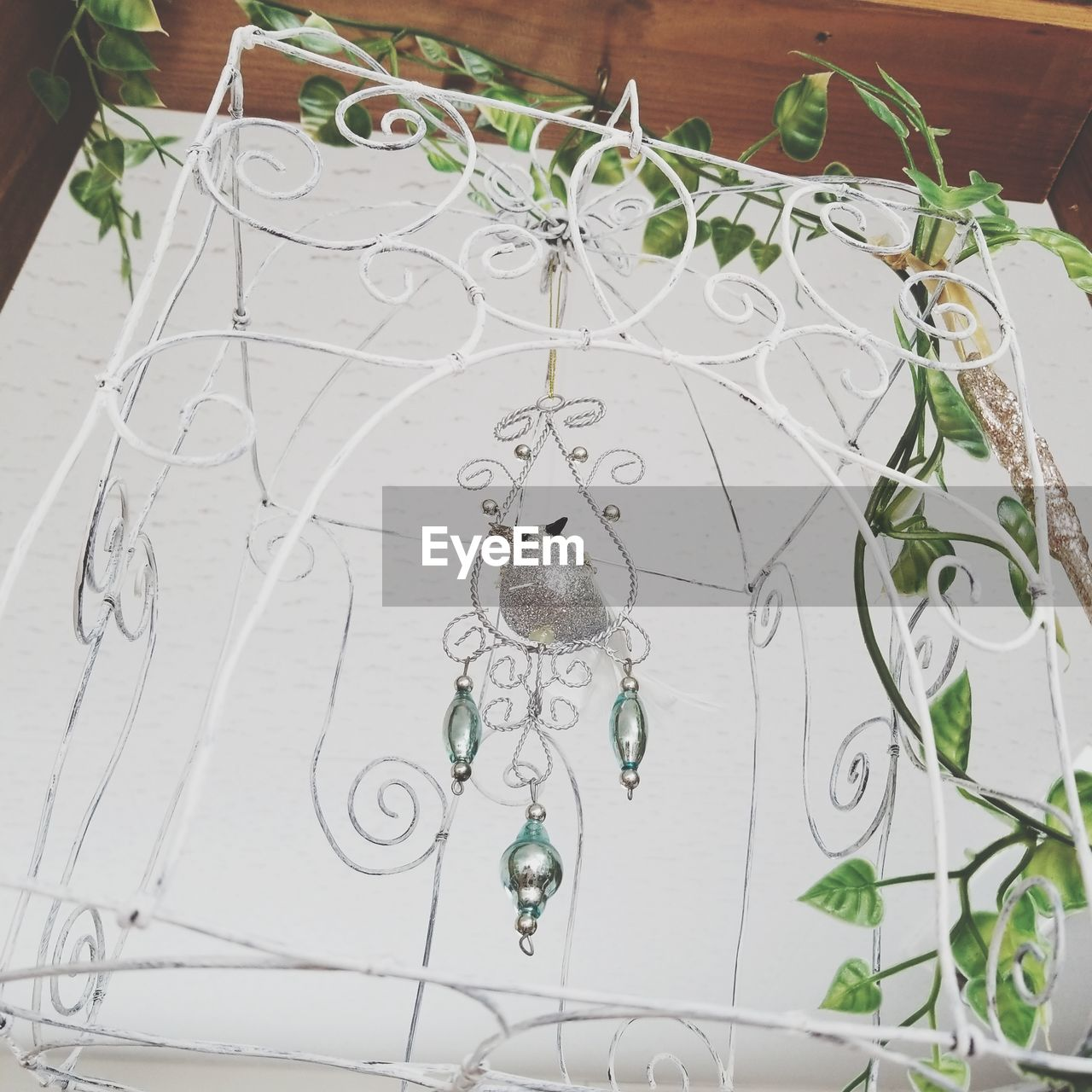 hanging, no people, indoors, art and craft, decoration, close-up, design, high angle view, craft, white color, creativity, pattern, day, dreamcatcher, flooring, wall - building feature, nature, ceiling, metal, floral pattern