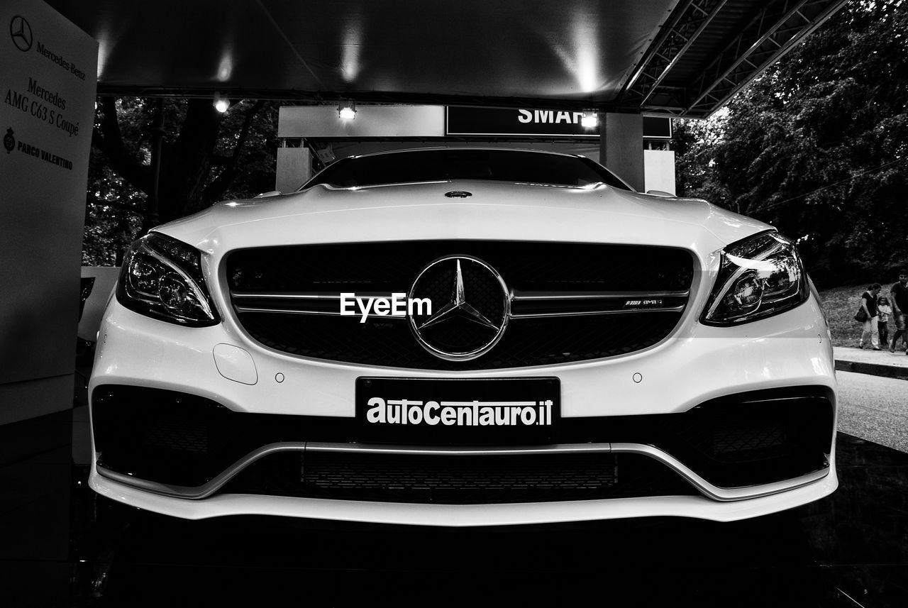 car, transportation, text, land vehicle, old-fashioned, communication, night, no people, indoors, illuminated, close-up