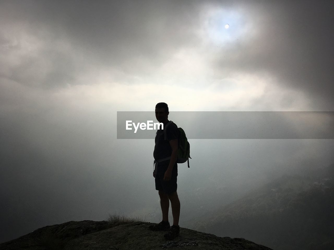sky, standing, real people, one person, cloud - sky, full length, beauty in nature, leisure activity, scenics - nature, mountain, men, fog, hiking, tranquility, nature, lifestyles, non-urban scene, tranquil scene, outdoors, looking at view