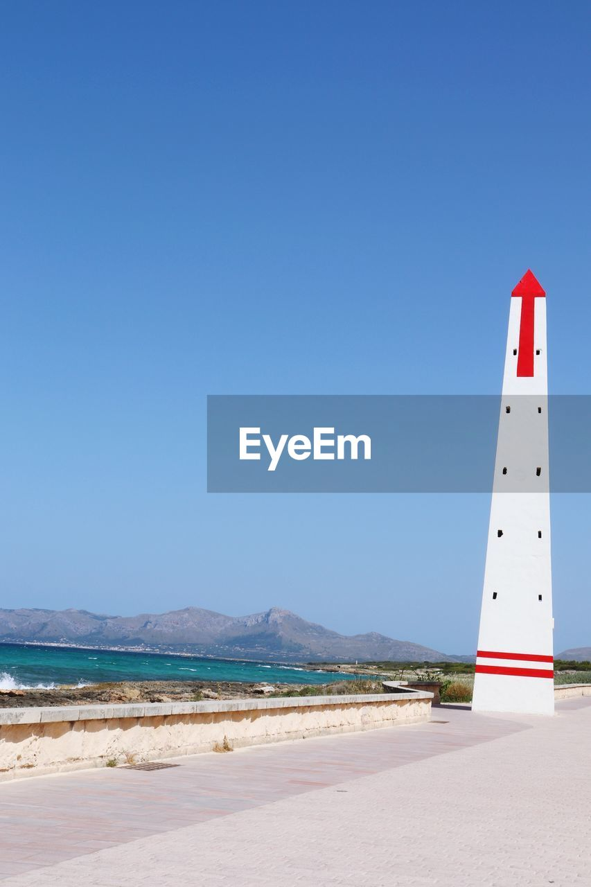 sky, clear sky, copy space, blue, water, land, beach, sea, day, guidance, nature, tower, beauty in nature, scenics - nature, security, no people, lighthouse, safety, protection, outdoors