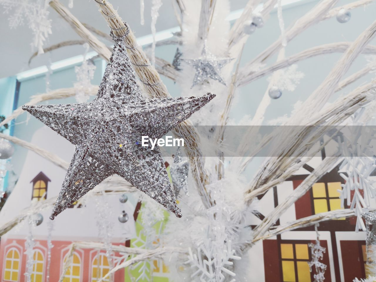 Low angle view of star shape on christmas tree during winter