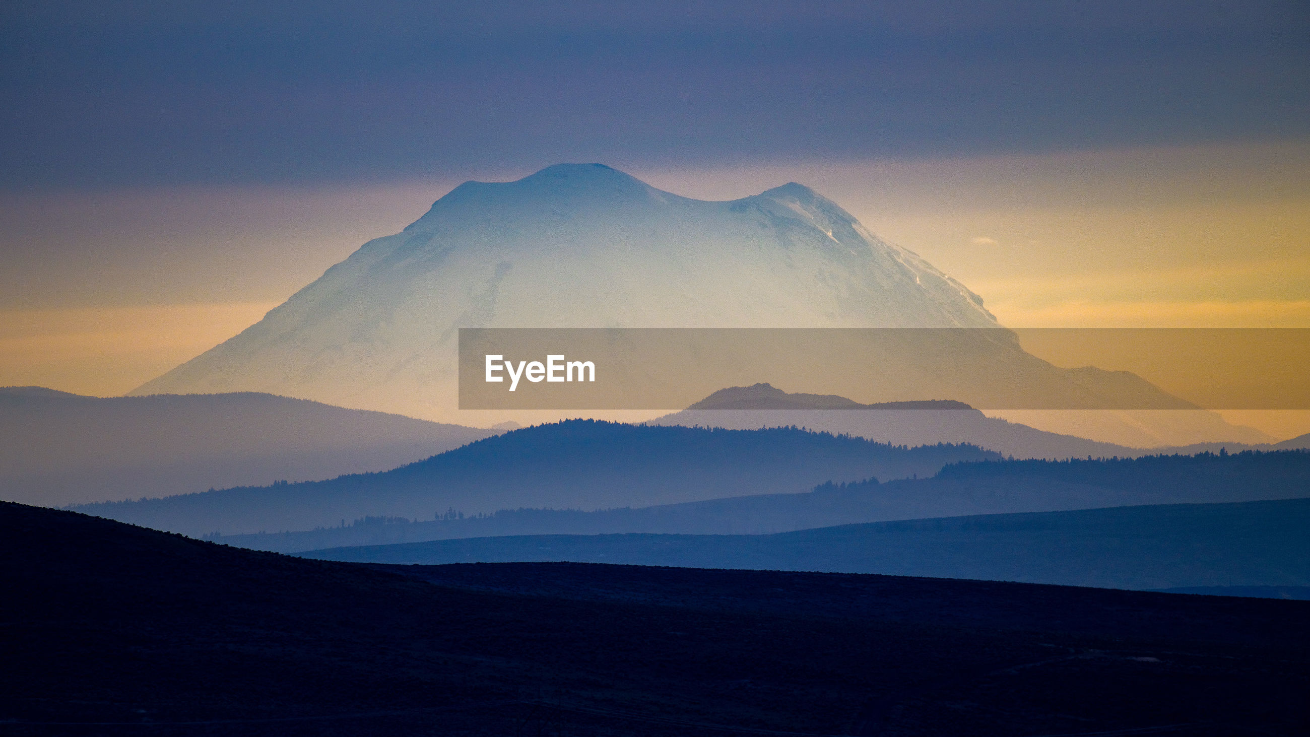 SCENIC VIEW OF VOLCANIC MOUNTAINS AGAINST SKY DURING SUNSET