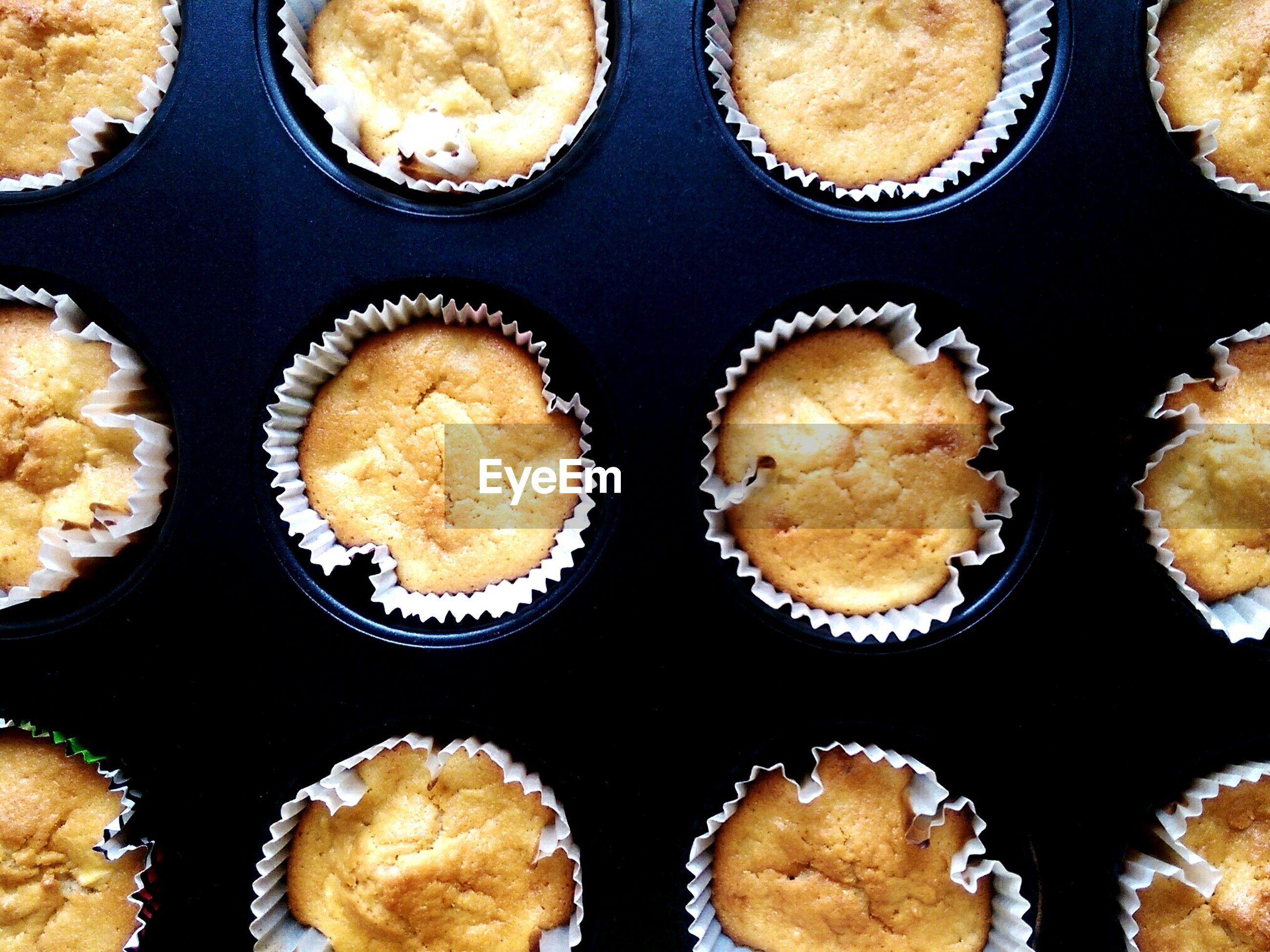 Full frame shot of apple muffins on table