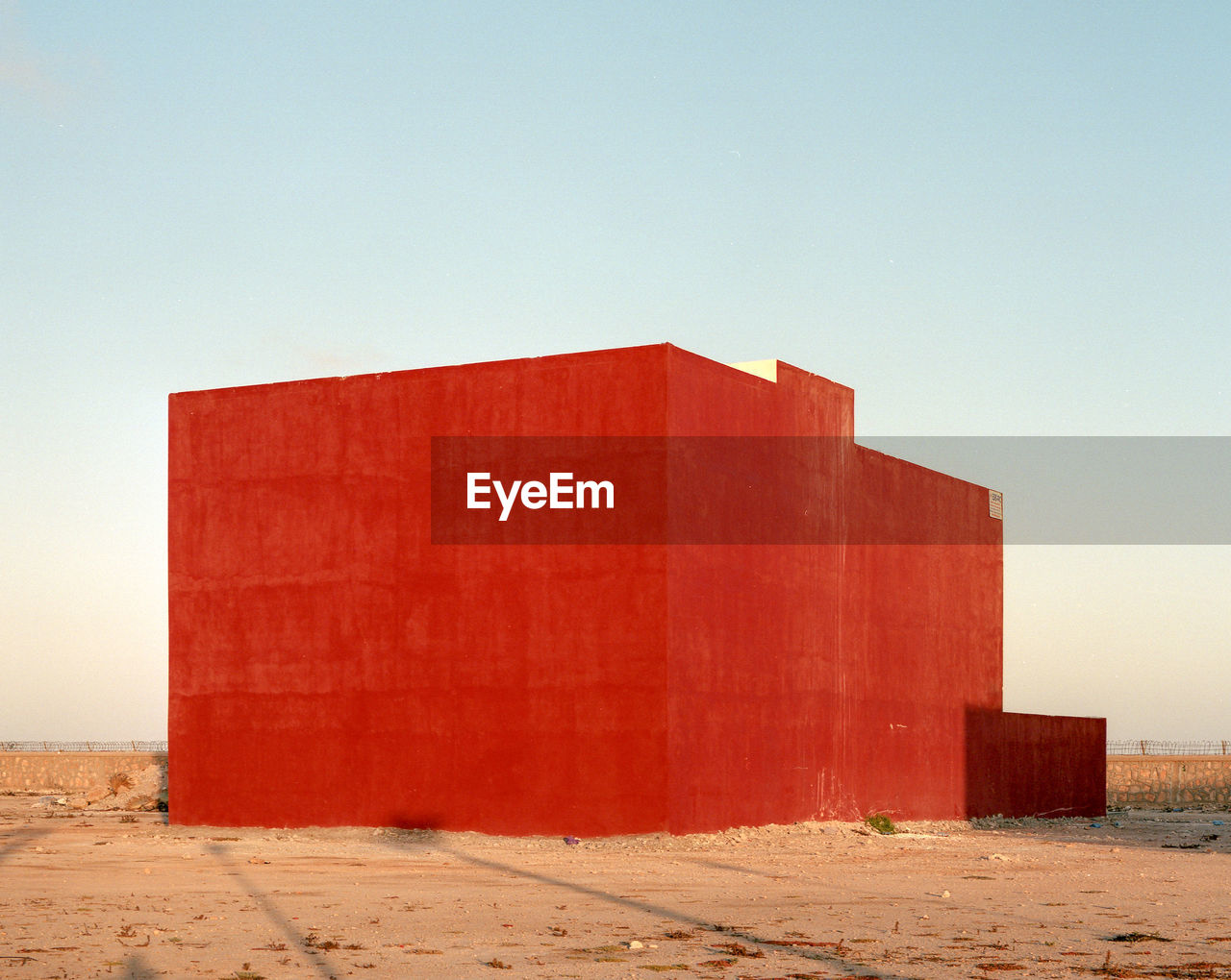 RED BUILDING AGAINST SKY