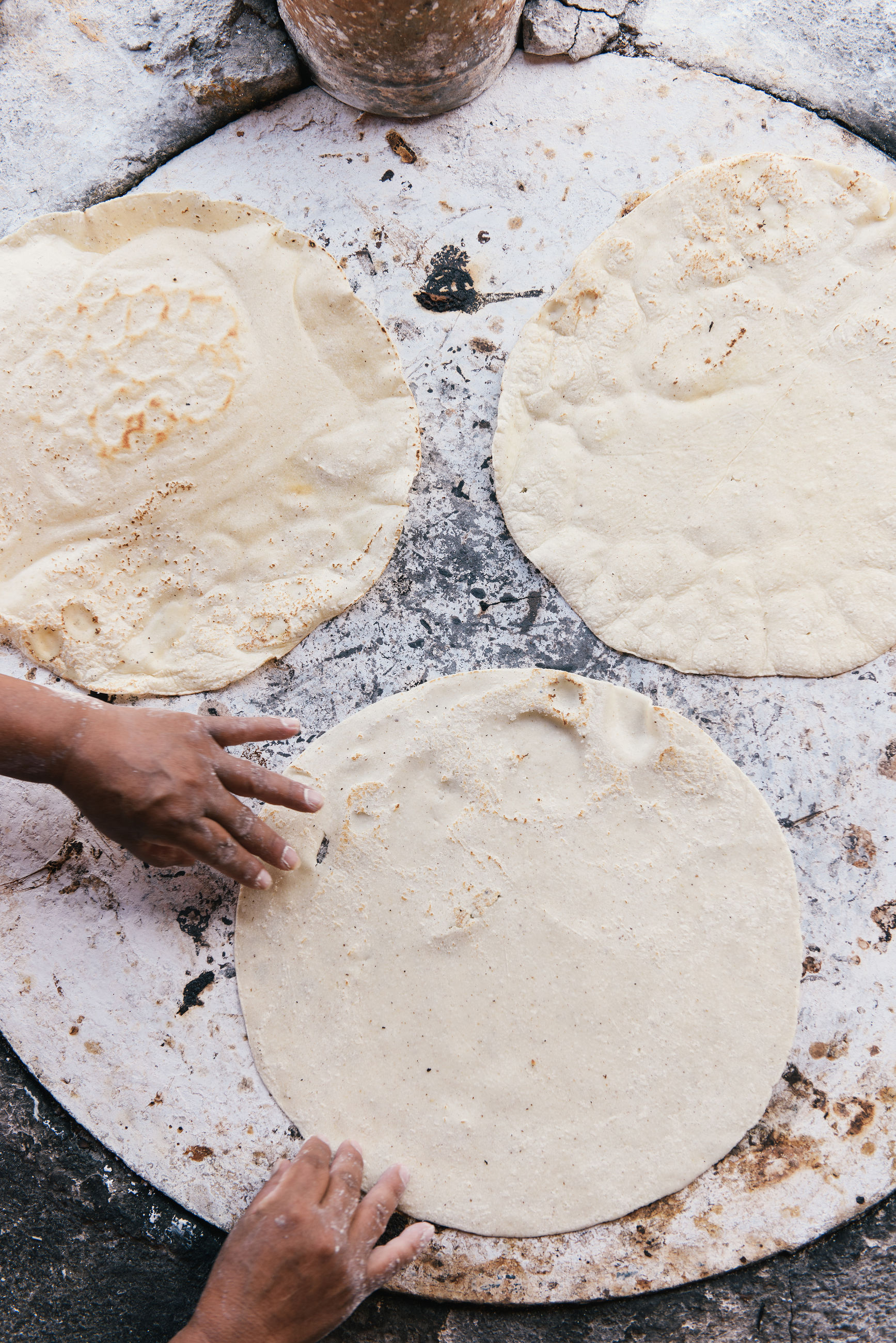 HIGH ANGLE VIEW OF WOMAN PREPARING BREAD
