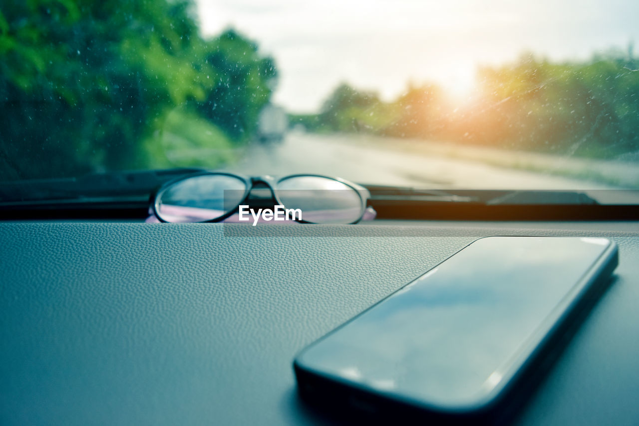 car, glass - material, motor vehicle, transportation, land vehicle, transparent, mode of transportation, vehicle interior, close-up, drop, window, no people, water, indoors, car interior, day, reflection, nature, selective focus, rain, raindrop, rainy season, personal accessory