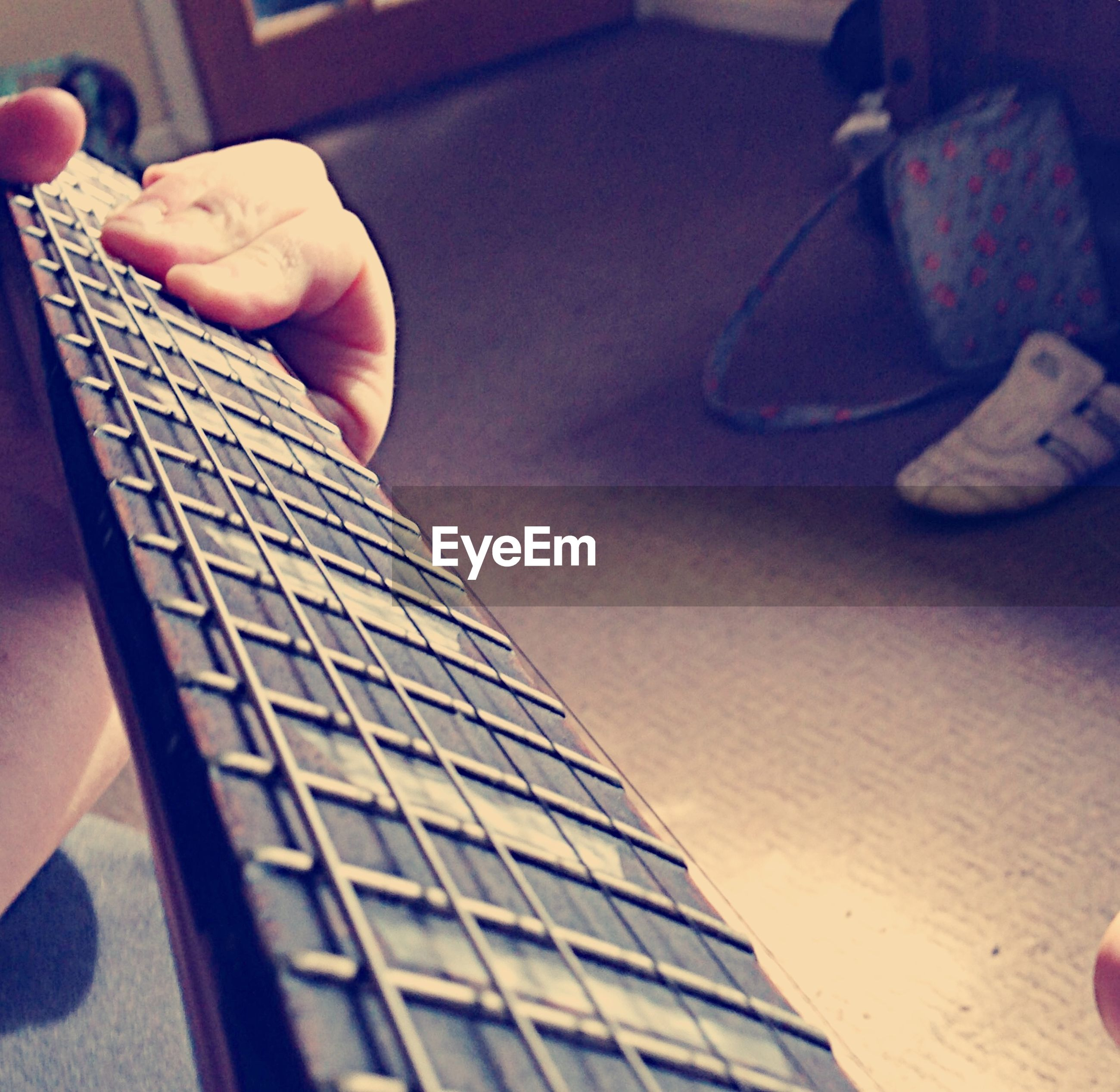indoors, person, part of, cropped, holding, home interior, music, human finger, lifestyles, leisure activity, musical instrument, high angle view, communication, wireless technology, musical equipment, close-up, unrecognizable person