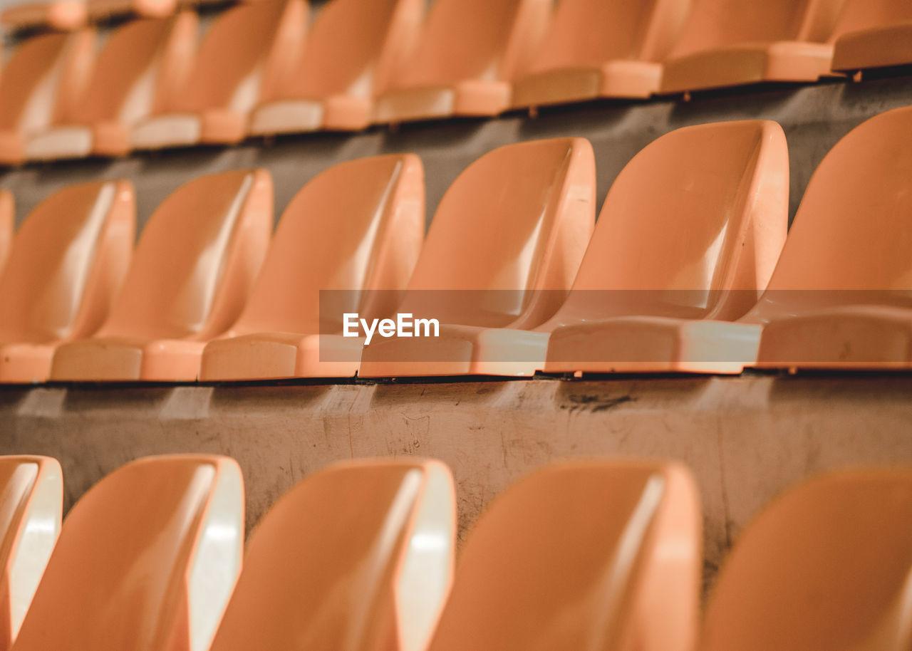 CLOSE-UP OF SEATS IN STADIUM