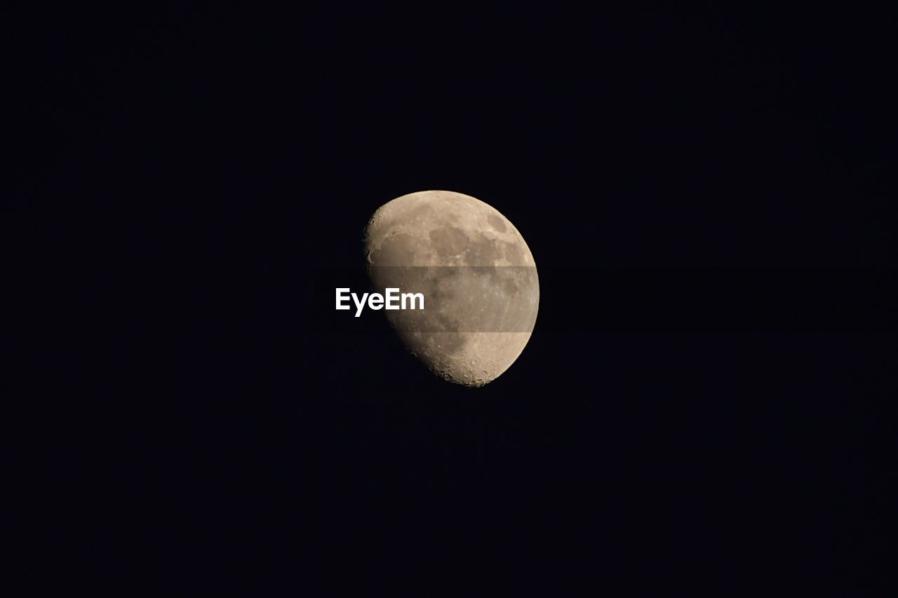 moon, astronomy, night, beauty in nature, moon surface, planetary moon, nature, copy space, tranquility, scenics, majestic, low angle view, tranquil scene, idyllic, space exploration, half moon, no people, discovery, outdoors, space, clear sky, sky