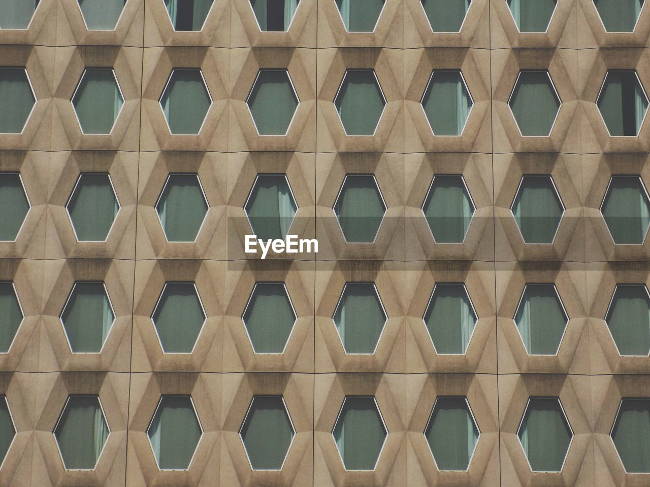 full frame, backgrounds, pattern, no people, repetition, built structure, low angle view, architecture, day, design, side by side, building exterior, geometric shape, shape, building, outdoors, sunlight, in a row, architectural feature, close-up