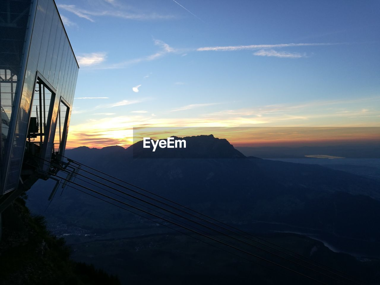 Overhead Cable Car Station Against Mountains During Sunset