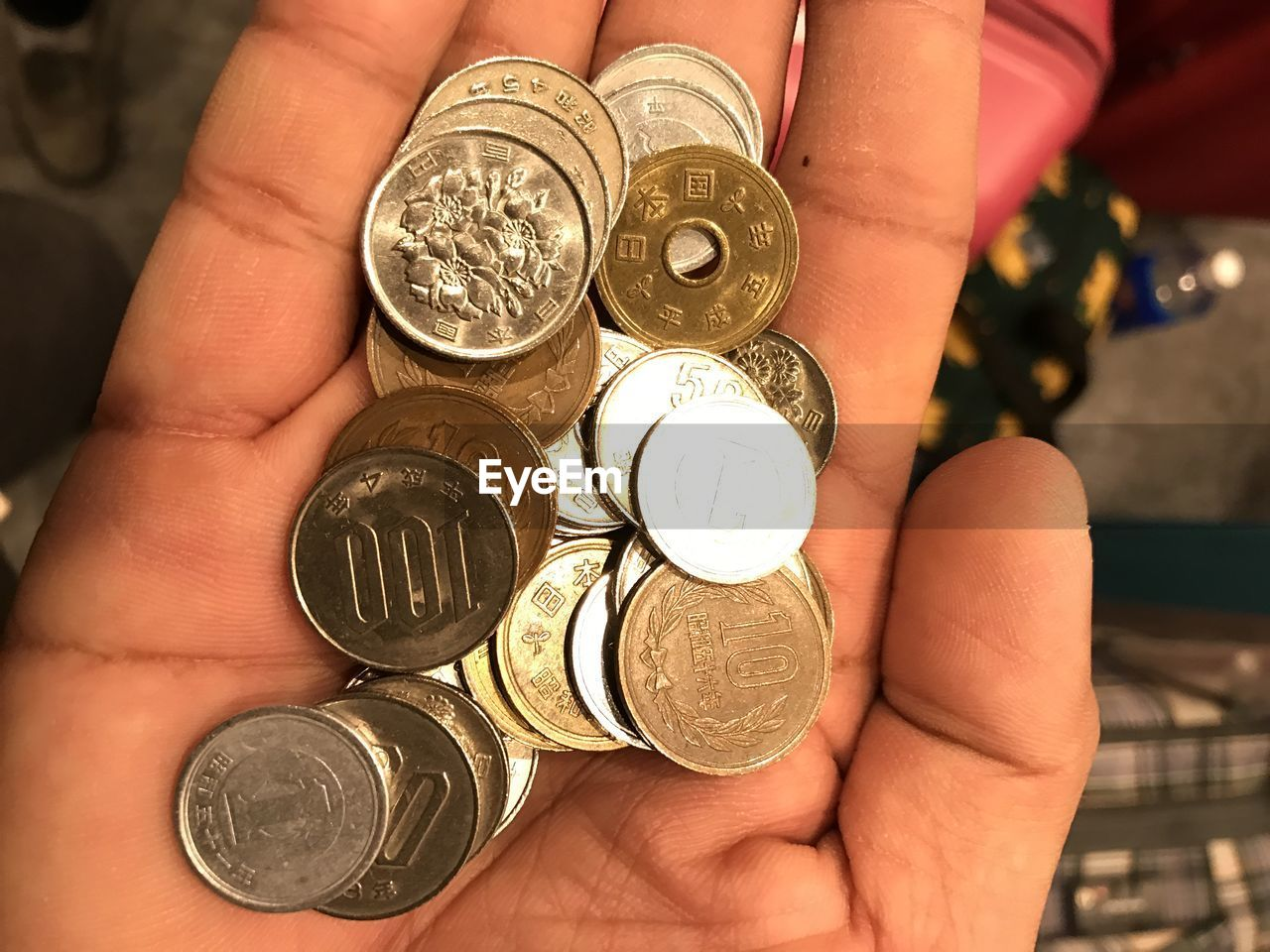Cropped hand holding coins