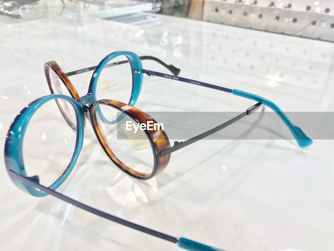 still life, close-up, table, glasses, high angle view, eyeglasses, indoors, medical equipment, healthcare and medicine, no people, focus on foreground, security, protection, eyesight, white color, stethoscope, personal accessory, blue, glass - material, transparent, eyewear