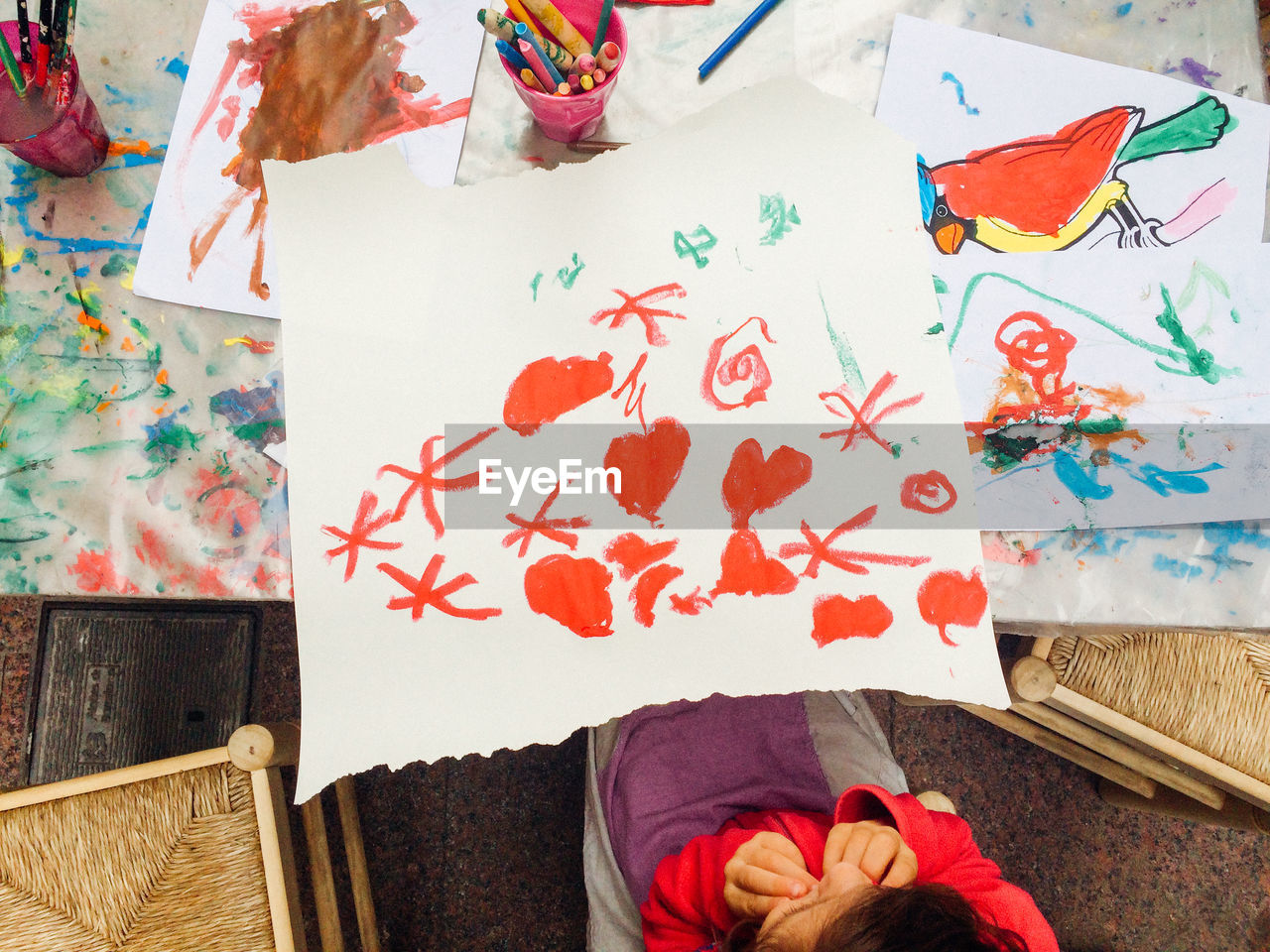 High Angle View Of Girl Drawing At Table