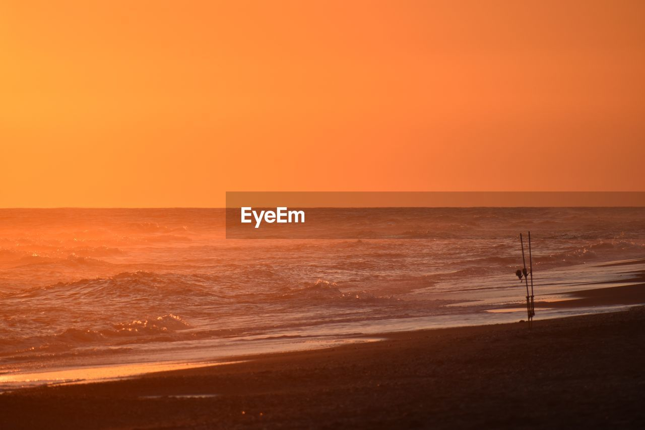 sunset, sea, sky, water, land, horizon, beauty in nature, scenics - nature, horizon over water, beach, orange color, motion, nature, tranquil scene, wave, tranquility, sand, copy space, no people, outdoors