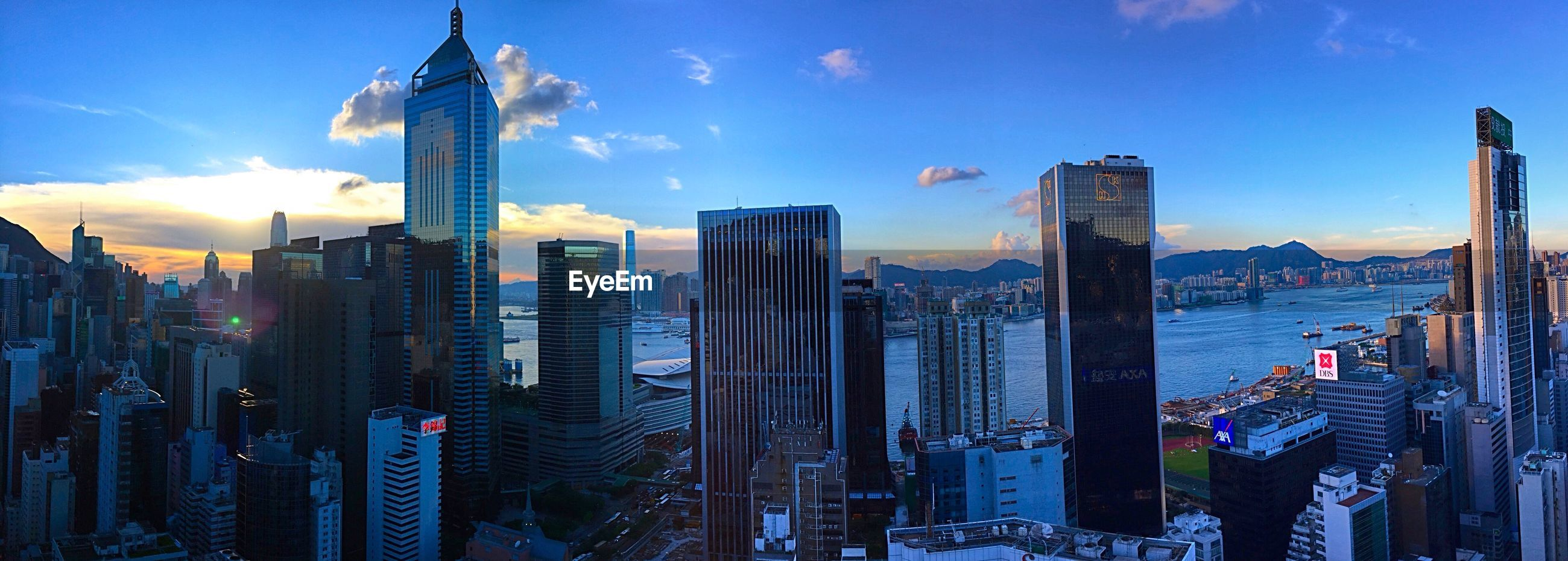 building exterior, city, architecture, skyscraper, built structure, cityscape, tall - high, modern, office building, sky, tower, urban skyline, financial district, city life, capital cities, cloud - sky, downtown district, panoramic, development, skyline