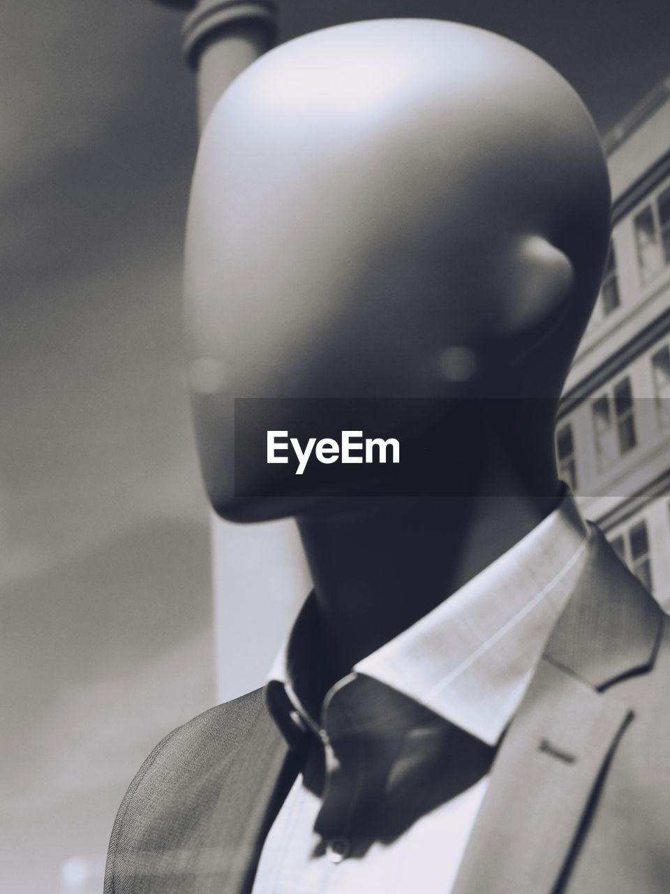mannequin, human representation, clothing, one person, headshot, real people, close-up, focus on foreground, portrait, men, male likeness, suit, representation, lifestyles, headwear, well-dressed, uniform, indoors, business, government, obscured face