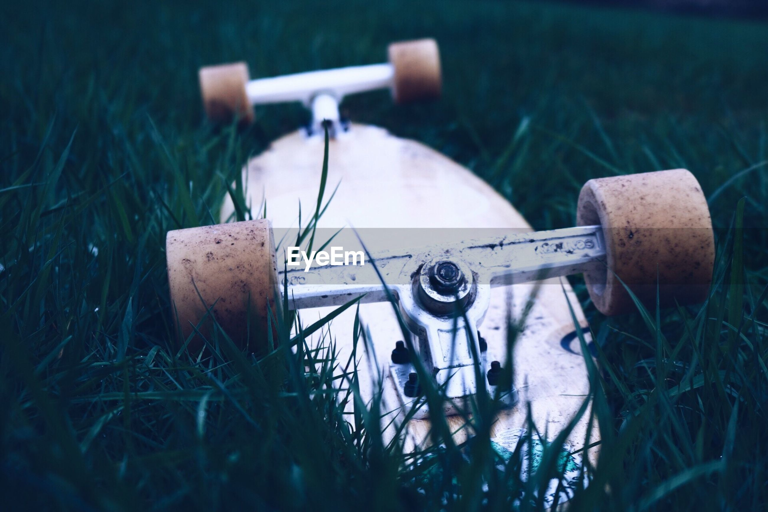 Close-up of skateboard on field