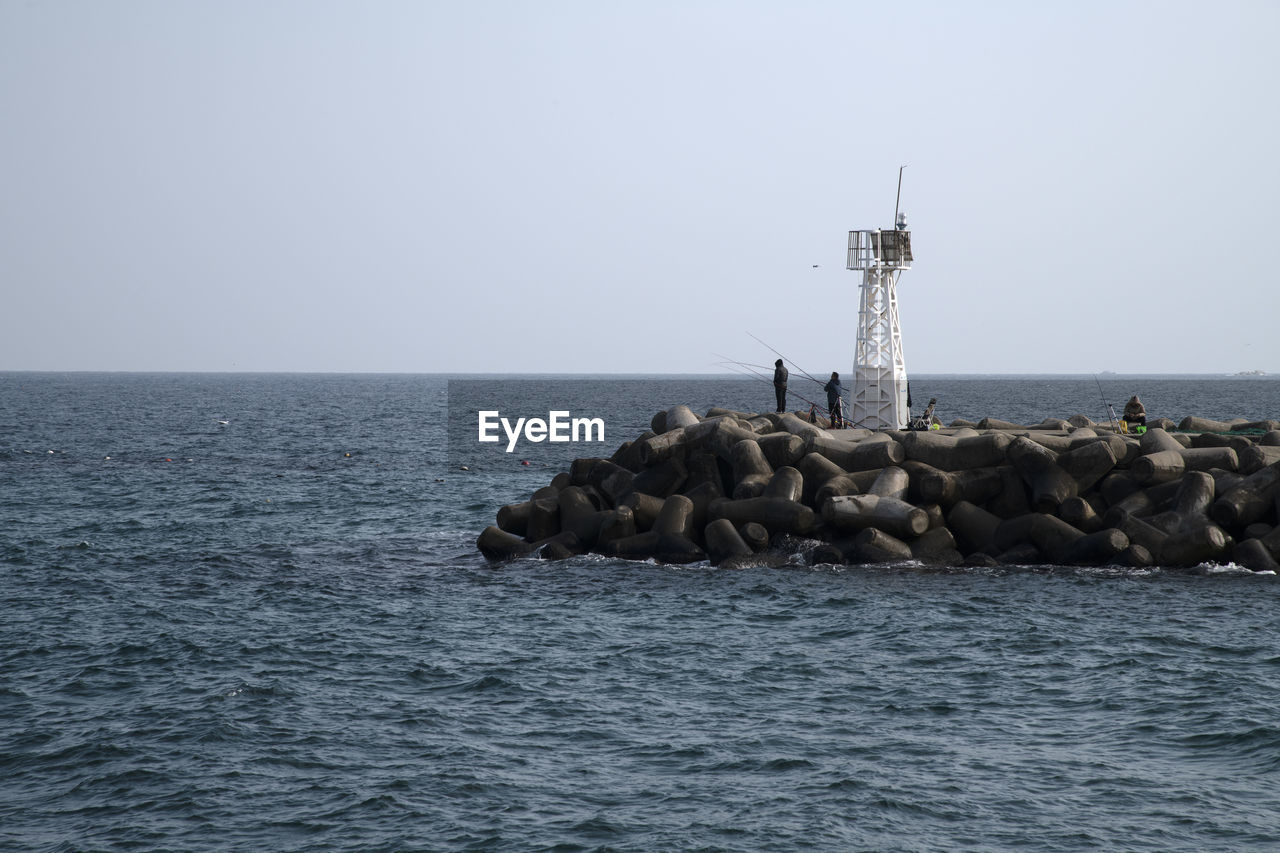 sea, water, horizon, horizon over water, waterfront, sky, solid, clear sky, guidance, tower, scenics - nature, beauty in nature, security, rock, lighthouse, nature, tranquil scene, rock - object, copy space, no people, groyne