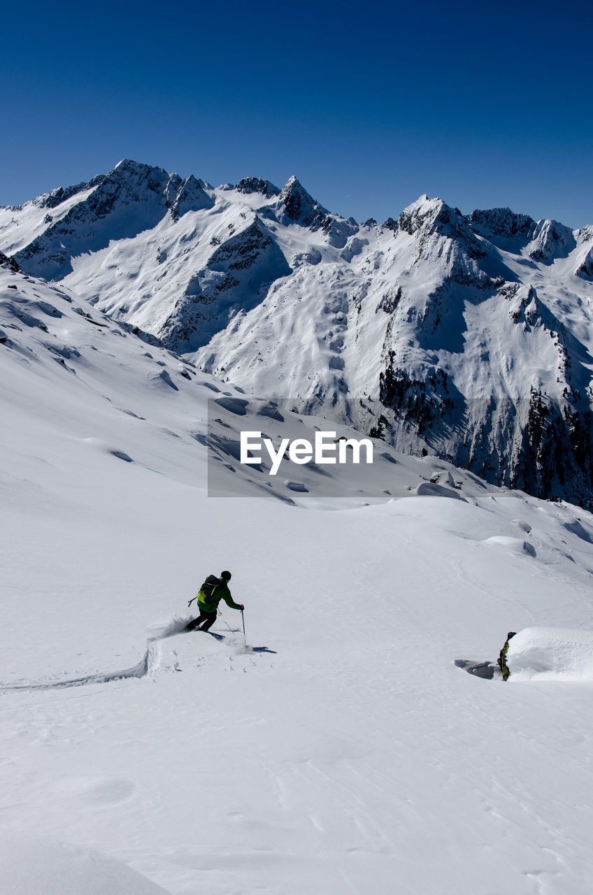 High Angle View Of Person Skiing On Snow Landscape